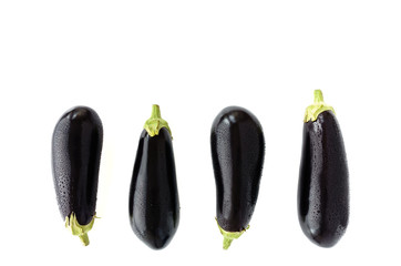 Aubergines with Water Drops on White Background