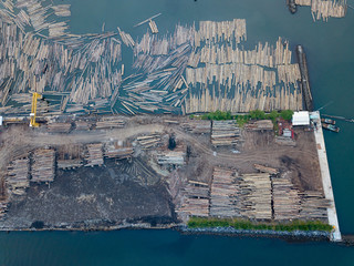 Dock station for tradditional woodstock with lot of wooden prepare for ships and boat, photo from drone at bird eye view