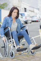 a person in a wheelchair faces difficulties with transportation