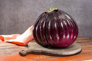 Israeli Huge Baladi Big ripe whole raw violet eggplant on table