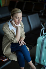 Thoughtful female commuter waiting in waiting area