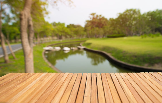 Front of wooden floor with open space on the back yard and pond