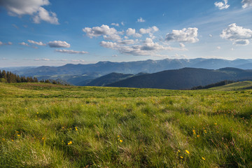 Mountain summer panoramic landscape with blue sky and clouds. Carpathians