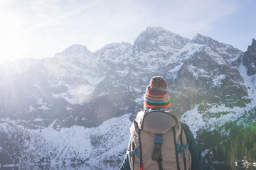 Female hiker looking at snow capped mountain