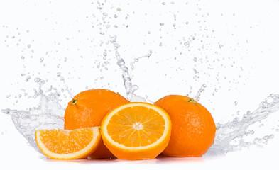 Fresh oranges with water splash