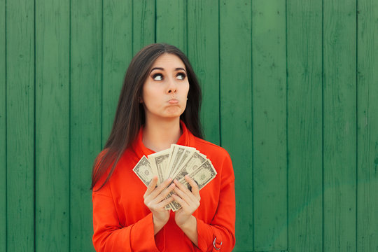 Funny Casual Girl Holding Money Ready to Make Payment