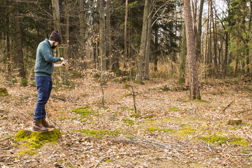 man taking photo with smartphone in the forest