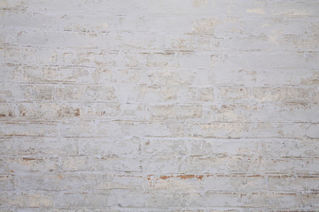 Old scratched white brick wall. Texture.