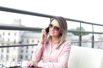 business concept - businesswoman talking on the phone