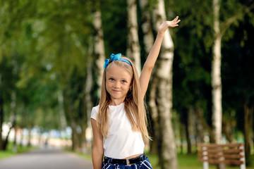 little girl in dress walking in summer park