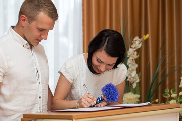 groom and bride in the registry office get married