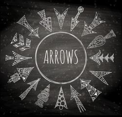 Vector arrows painted by hand. Stylized hand-drawn pointer. Linear geometric arrows on a chalkboard background. Set of design elements in zentangle style.