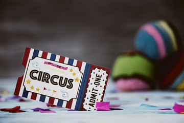 circus admission ticket and juggling balls.