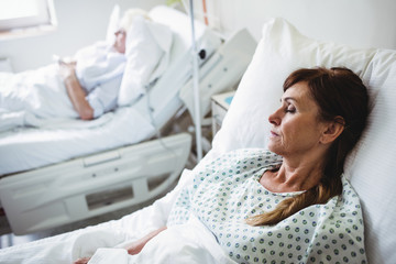 Female patient sleeping on a bed