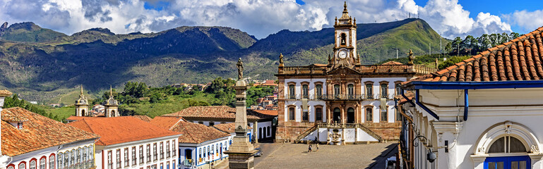 Panoramic view from above the central square of the historic city of Ouro Preto with the museum of the inconfidence and the hills in the background