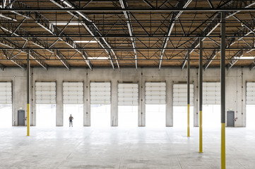 Owner standing in loading dock door