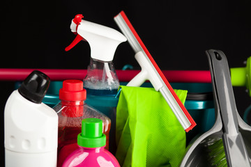 Fotoväggar - Cleaning supplies on black background