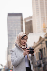 Woman in hijab looking at pictures