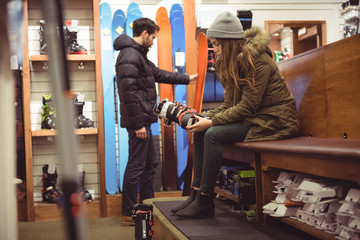 Woman selecting ski boot in a shop