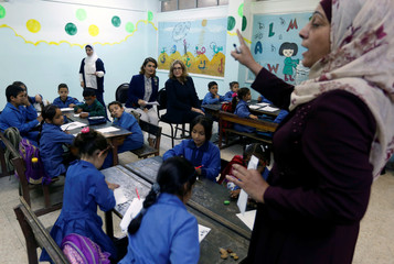 Britain's Secretary of State for International Development Penny Mordaunt attends a class during her visit to a public school in Amman