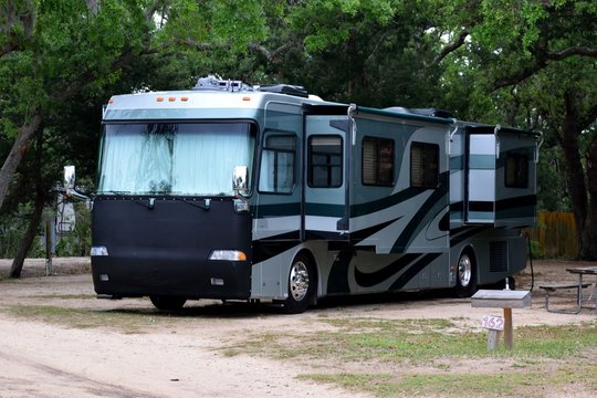 Recreational vehicle at campsite background