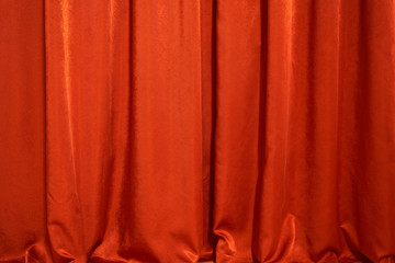 creases on a red curtain