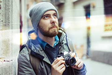 Male tourist with retro camera