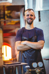 Portrait of glassblower with arms crossed