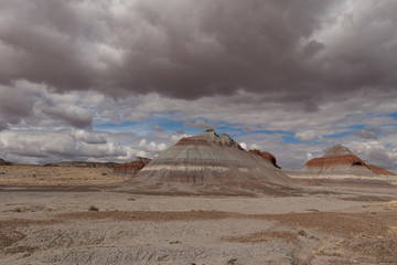 Painted Desert at Petrified Forest National Park with cloudy skies in background