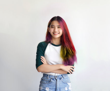 pretty asian female smiling joyfully with colorful hair in dressed casually like hipster lifestyle