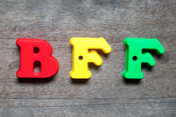 Color alphabet in word BFF (Abbreviation of best friend forever) on wood background