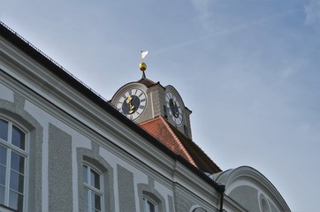 beautiful decorated clock at Nymphenburg castle in Munich in Germany