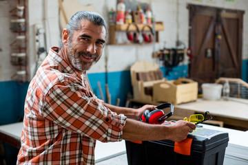 Portrait of carpenter in workshop