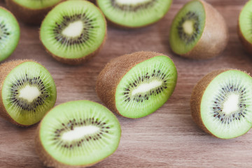 Green kiwis on the wooden background