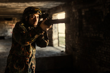 Soldier in the war to aim with weapons