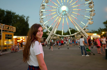 Tuinposter Amusementspark Teen girl in amusement park