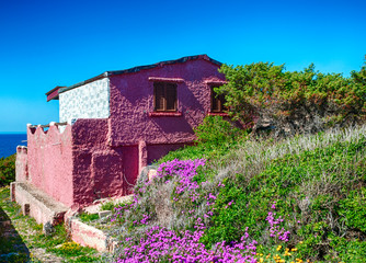 old pink house on the sea
