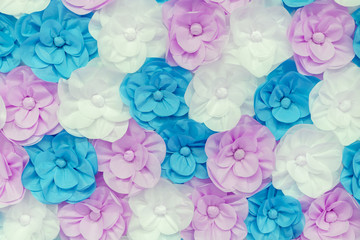 pink, blue and white flowers. Large colored paper flowers background