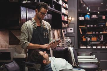 Barber beard style on digital tablet
