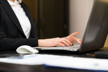 Woman using a laptop in her office