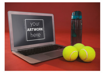 Laptop and Tennis Balls on Red Background Mockup