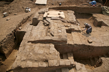 A worker is seen at Limon archaeological complex in Lambayeque