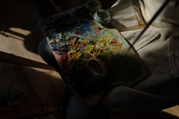 palette of oil paints. abstract of oil painting with brush strokes. Painter equipement  colors on workspace