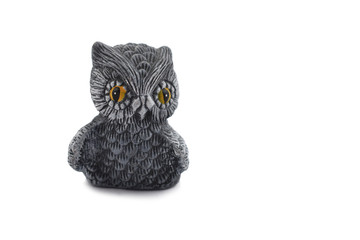Owl ceramic decoration stock images. Owl statue isolated on a white background. Owl home decor