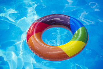 colorful swim ring or lifebuoy. inflatable ring float in pool blue water. Summer vacation and travel to ocean, Bahamas. Maldives or Miami beach. Relax in spa luxury swimming pool.