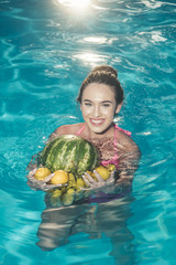 Dieting and healthy organic food, vegetarian. dieting with fresh banana fruit of woman in pool