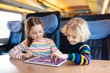 Kids travel by train. Railway trip with child.
