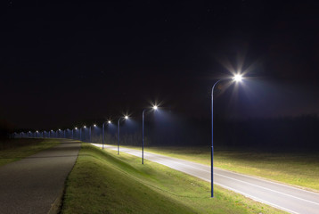 empty street at night with modern LED streetlights