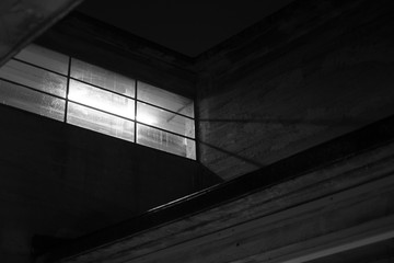 Fluorescent Light glowing through Window at Night