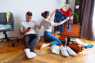 man assist woman with packing. gathering for trip. travel concept